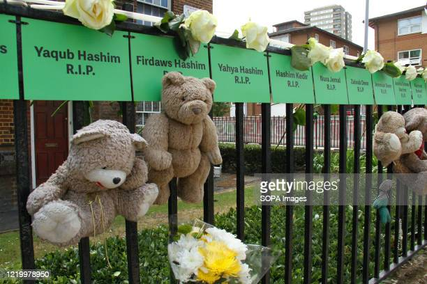 Green cards with names of victims pegged on the fence of Brabley House on Silchester Road W19 during the 3rd anniversary of the Grenfell fire...