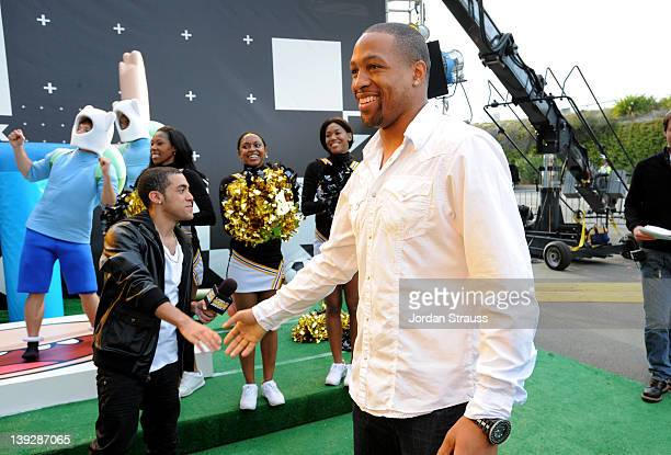 Green carpet host CJ Manigo and NFL player Michael Boley of the New York Giants arrive at the 2012 Cartoon Network Hall of Game Awards at Barker...
