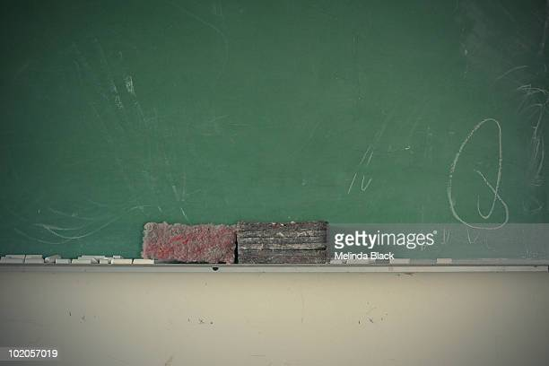 green chalkboard with chalk and erasers - blackboard visual aid stock photos and pictures