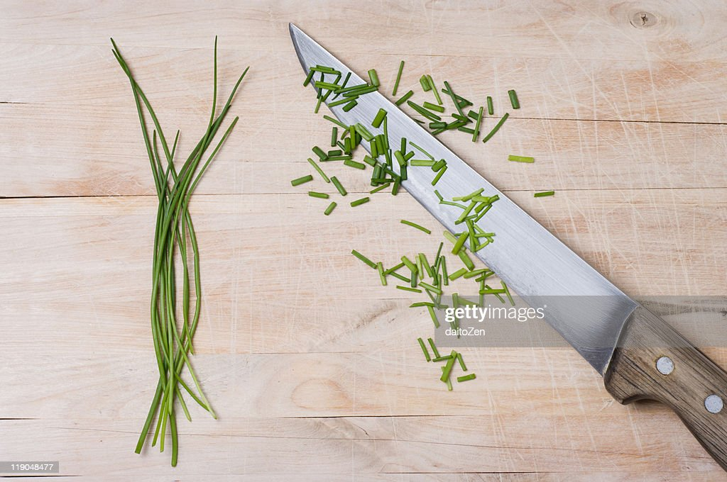 Green chives on cutting board : Stock Photo