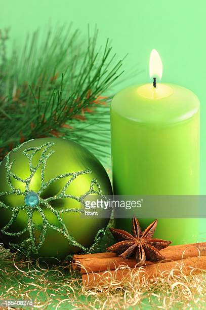 green Christmas ornament and candle