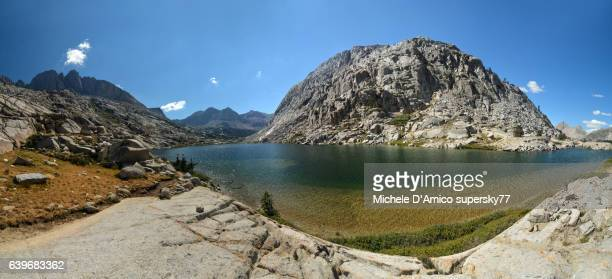 green clear alpine lake in the high sierra nevada - john muir trail stock photos and pictures