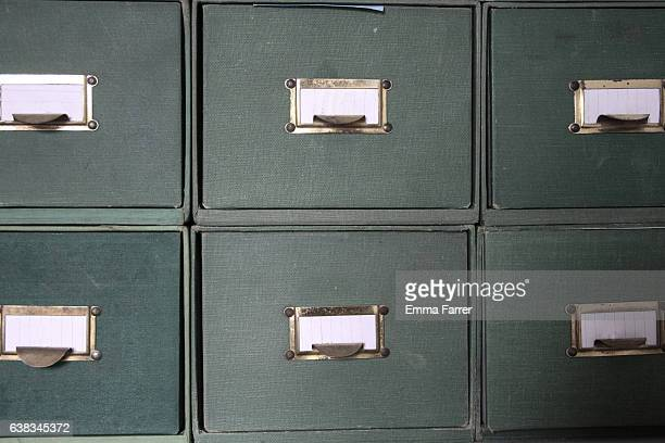 Green cloth bound catalogue drawers