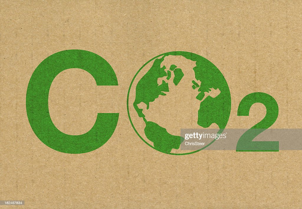 A green CO2 logo on a brown cardboard background : Stock Photo