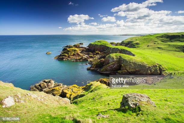 green coastline, west lothians, scotland, uk - scotland stock pictures, royalty-free photos & images