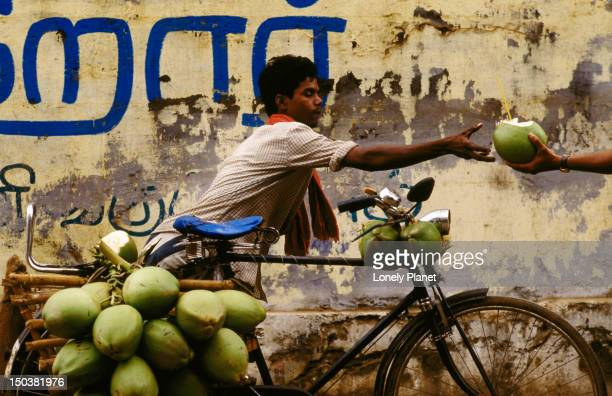Green coconut vendor selling from his bicycle - Tamil Nadu