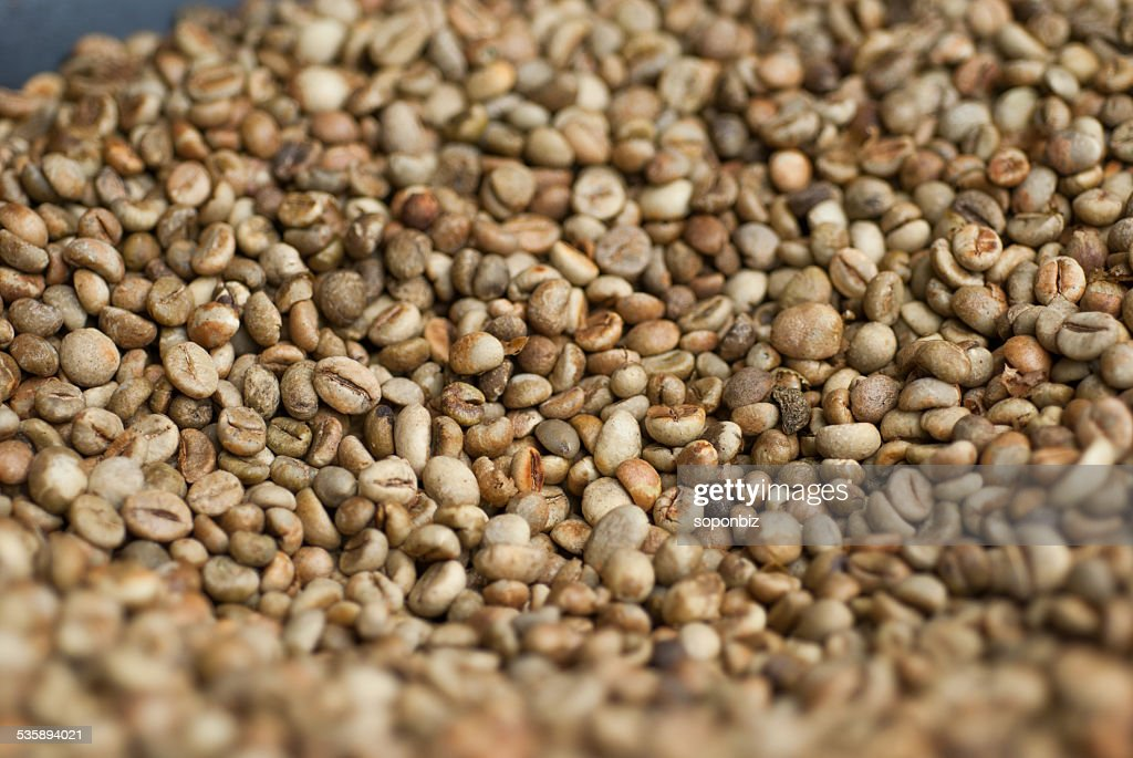 Green coffee beans in a pan : Stock Photo
