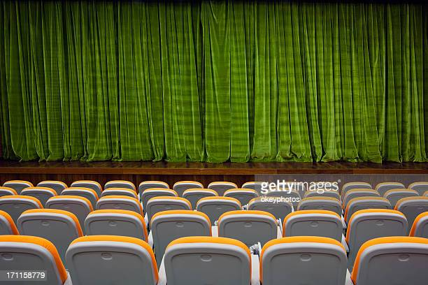 Green color velvet curtain and seats