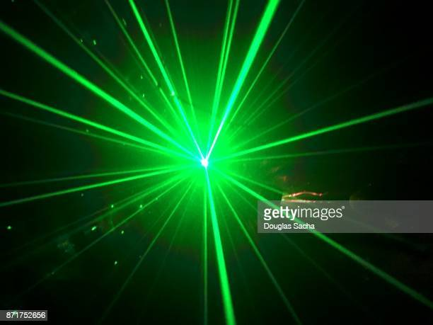 Green colored laser light in a dark room