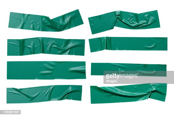 green colored plastic adhesive tape stripes - sticker stock pictures, royalty-free photos & images