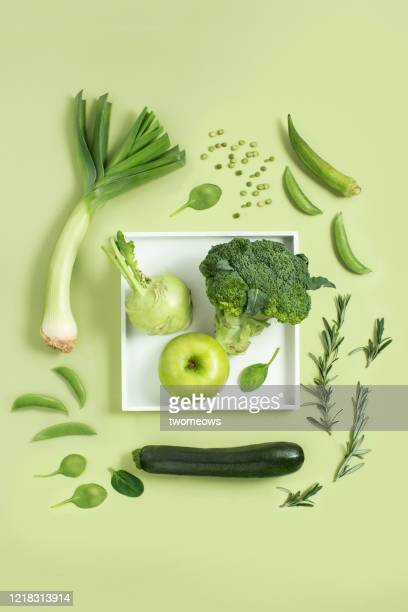 green colour vegan food still life image. - slice stock pictures, royalty-free photos & images