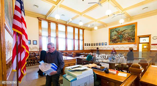 Green County Clerk Michael Doyle carries ballots to a secure location after being tabulated during the presidential recount on December 1 2016 at the...