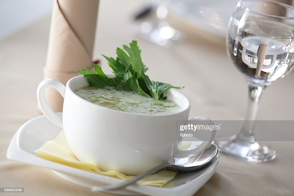 green creamy soup in restaurant : Stock Photo