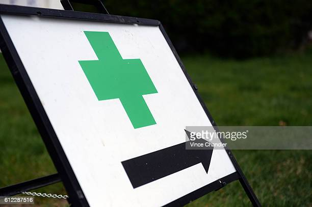 A green cross directs customers to the entrance of The Health Center a cannabis dispensary in Denver The green cross is used in European countries to...