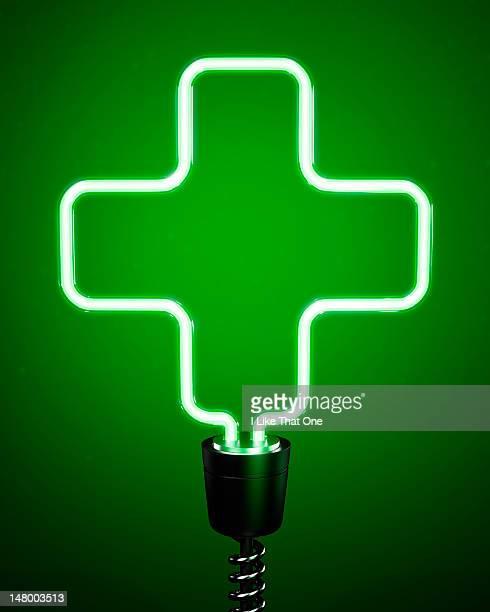 Green, cross shaped energy saving eco lightbulb