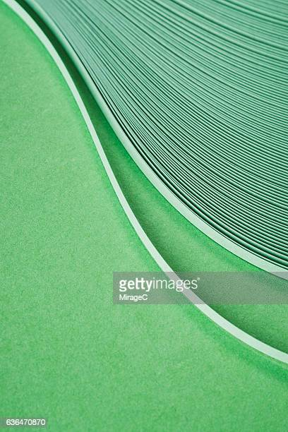Green Curved Paper Stripes Stack