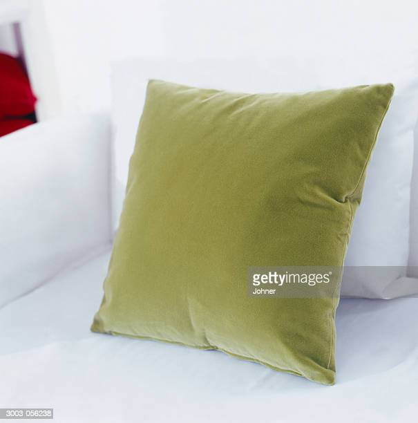 green cushion on sofa - cushion stock photos and pictures