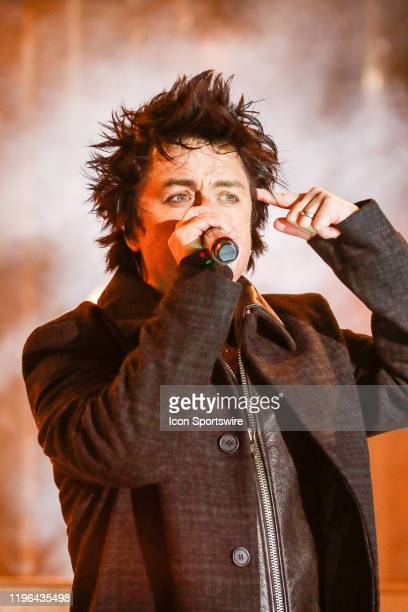 Green Day lead singer Billy Joe Armstrong points to his head during performance prior to the 2020 NHL AllStar Game on January 25 at Enterprise Center...