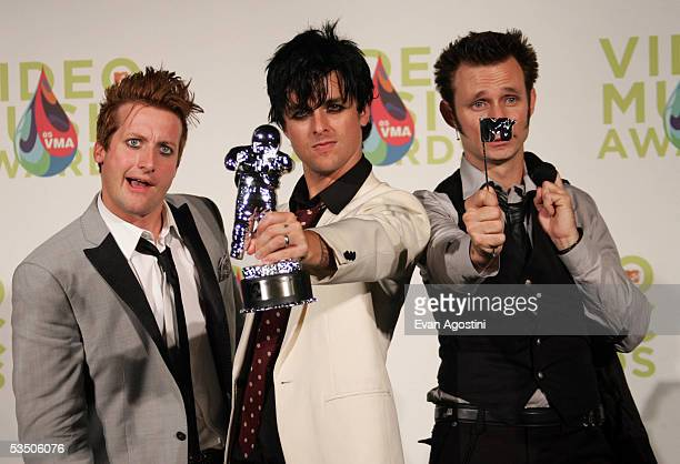 Green Day's Tre Cool Billie Joe Armstrong and Mike Dirnt pose in the press room with their award for Video of the Year for Boulevard of Broken Dreams...