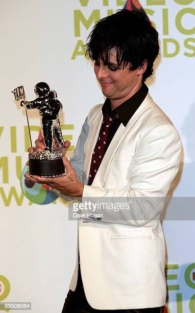 Green Days's Billie Joe Armstrong poses in the press room with his award for Best Video of the Year for Boulevard of Broken Dreams during the 2005...