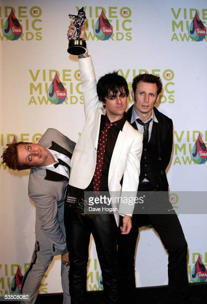 Green Days's Tre Cool Billie Joe Armstrong and Mike Dirnt of Green Day poses in the press room with his award for Best Video of the Year for...