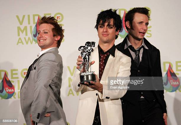 Green Days's Tre Cool Billie Joe Armstrong and Mike Dirnt pose in the press room with their award for Video of the Year for Boulevard of Broken...
