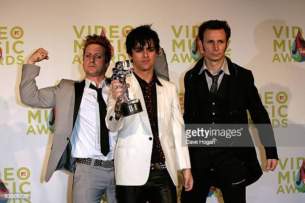 Green Days's Tre Cool Billie Joe Armstrong and Mike Dirnt pose in the press room with their award for Best Video of the Year for Boulevard of Broken...