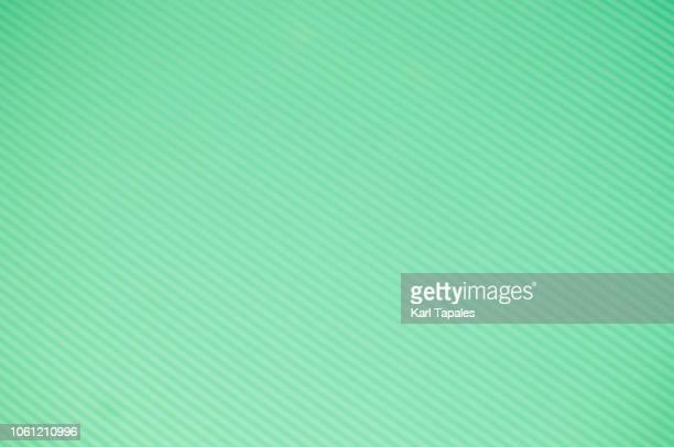 Green diagonal striped background