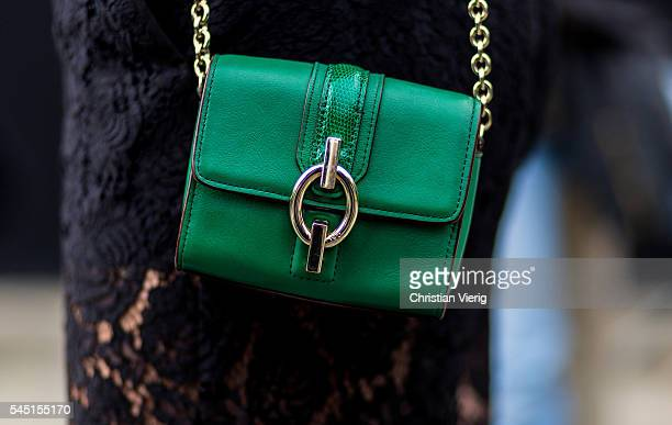 A green Diane von Fuerstenberg bag outside Chanel during Paris Fashion Week Haute Couture F/W 2016/2017 on July 5 2016 in Paris France
