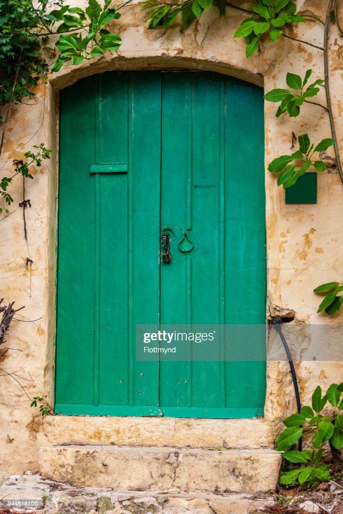 Green door in a limestone house, Gozo Malta : Stock Photo