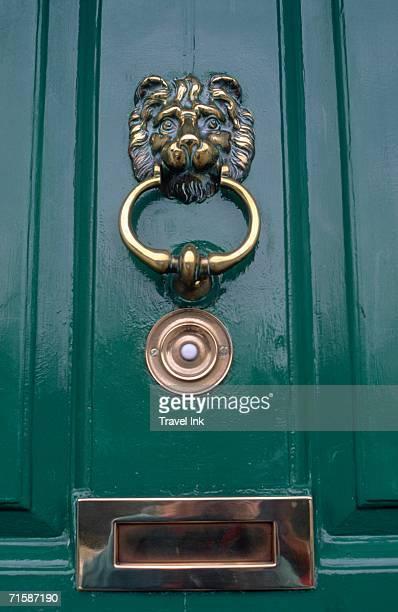 green door with brass door knocker and mail box - door knocker stock photos and pictures