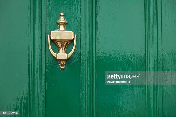 green door with brass knocker - door knocker stock photos and pictures