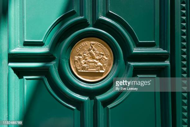 green door with golden plaque - carving craft product stock pictures, royalty-free photos & images