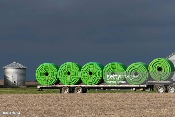 Green Drainage Hose and Grain Silo