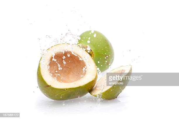 green drink coconut splashing - coconut water stock pictures, royalty-free photos & images