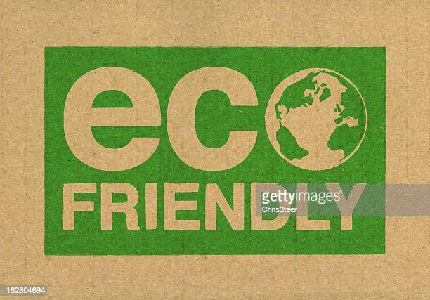 A green eco friendly symbol on brown cardboard