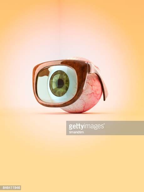 Green eye with mono glasses
