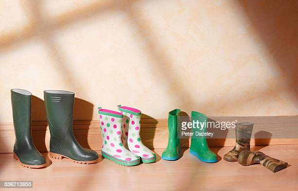 green family boots in a line - rubber boot stock pictures, royalty-free photos & images