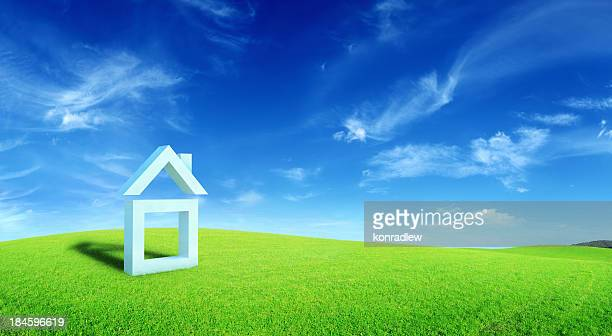Green Field Landscape and Symbolic House