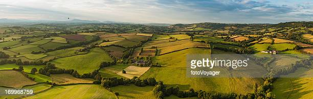 Green fields farms summer landscape aerial panorama
