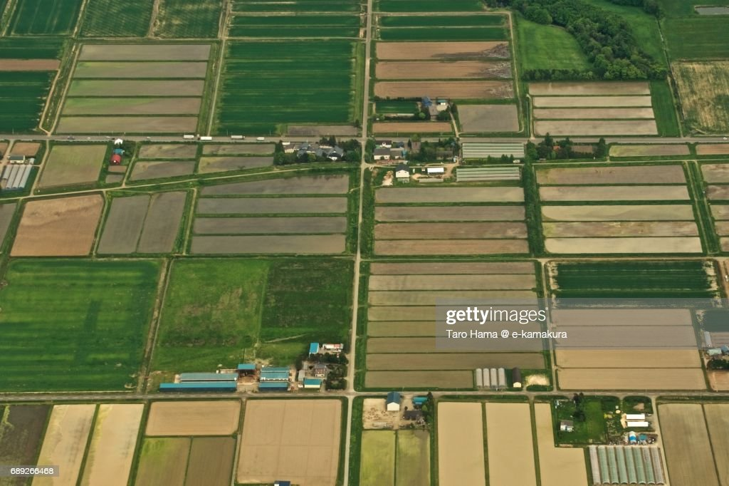 Green fields in Naganuma town in Hokkaido daytime aerial view from airplane : Stock Photo