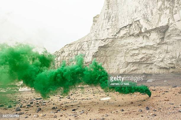 green flare on beach with chalk cliff - explosive stock pictures, royalty-free photos & images
