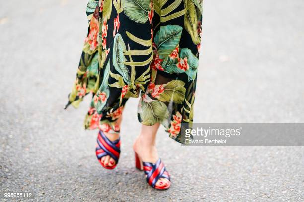 A green floral print dress and blue and red shoes outside Vetements during Paris Fashion Week Haute Couture Fall Winter 2018/2019 on July 1 2018 in...