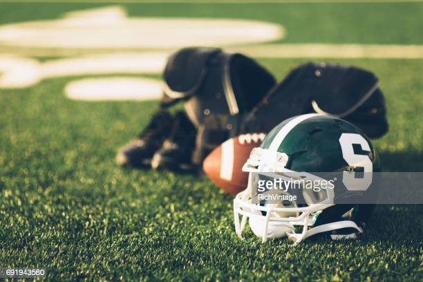 green football helmet on field - michigan state university football stock pictures, royalty-free photos & images