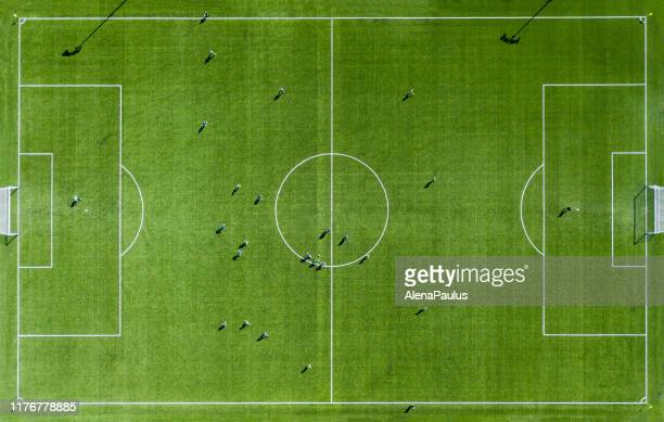 green football pitch aerial view - football field stock pictures, royalty-free photos & images