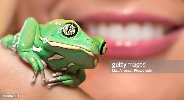 Green frog / woman with nice lips mouth and teeth.