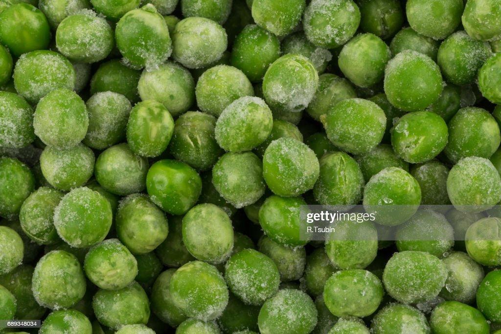 Green frozen raw peas : Stock Photo