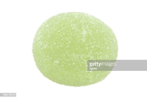 green fruit gum drop - gum drop stock photos and pictures