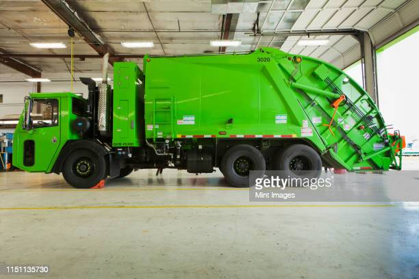 green garbage truck maintenance - garbage truck stock pictures, royalty-free photos & images