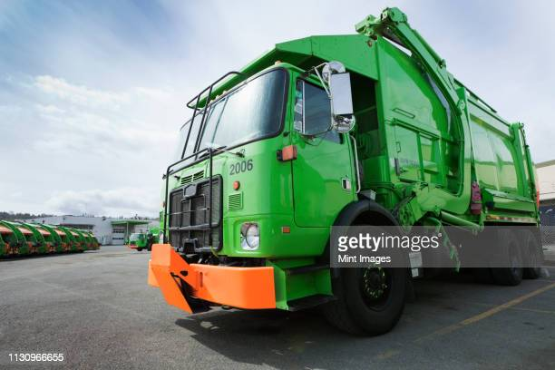 green garbage truck - waste management stock pictures, royalty-free photos & images